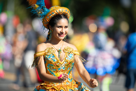 Washington, D.C., USA - September 29, 2018: The Fiesta DC Parade, Bolivian women wearing traditional clothing performing a traditional dance from bolivia