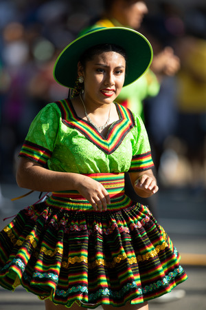 Washington, D.C., USA - September 29, 2018: The Fiesta DC Parade, Bolivian women wearing traditional clothing performing a traditional dance from bolivia 写真素材 - 116749393