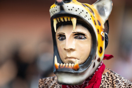 Chicago, Illinois , USA - September 9, 2018 The 26th Street Mexican Independence Parade, mexican man wearing traditional clothing representing the aztecs with a face mask in shape of a jaguar