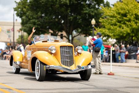 Auburn, Indiana, USA - September 9, 2018 The Auburn Cord Duesenberg Festival, An Auburn classic car driving down the street during the parade Éditoriale