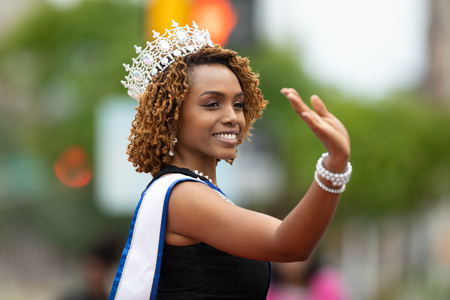 Indianapolis, Indiana, USA - September 22, 2018: The Circle City Classic Parade, African American Beauty Queem riding a car going down the road  during the parade Editorial