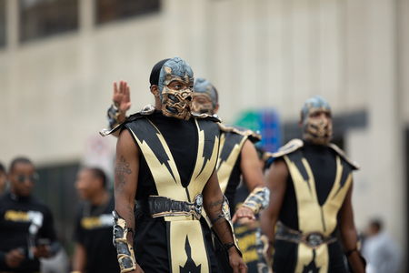 Indianapolis, Indiana, USA - September 22, 2018: The Circle City Classic Parade, Members of the Alpha Phi Alpha Fraternity INC dress up as Scorpion from mortal kombat at the parade Redakční