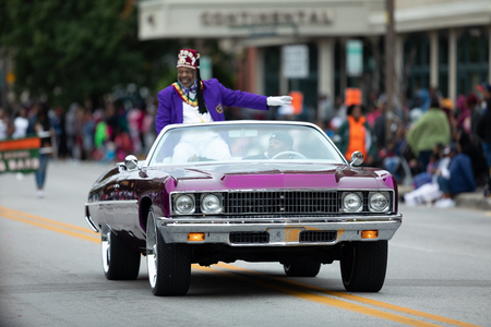 Indianapolis, Indiana, USA - September 22, 2018: The Circle City Classic Parade, Purple classic Donk Chevrolet car going down the road at the parade Editorial