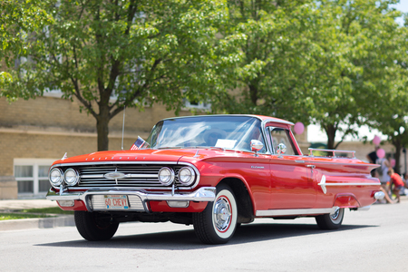 Kokomo, Indiana, USA - June 30, 2018: Haynes Apperson Parade, A Classic car Chevrolet El Camino color red, going down the road at the parade 報道画像