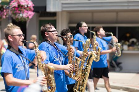 Kokomo, Indiana, USA - June 30, 2018: Haynes Apperson Parade, The Kokomo High School Marching Wildkats performing at the parade and wearing shirts that say Statuesque