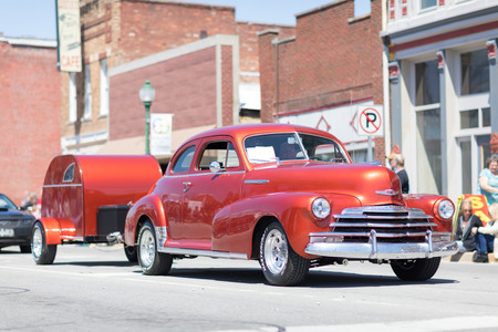 Orleans, Indiana, USA - April 28, 2018: The Orleans DogWood Festival and Parade, A classic car going down the street during the parade a Chevrolet Stylemaster color Red