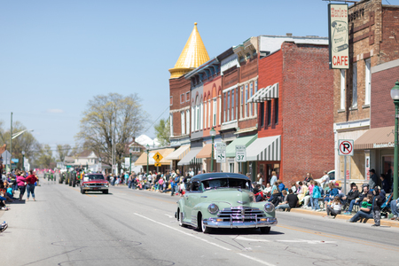 Orleans, Indiana, USA - April 28, 2018: The Orleans DogWood Festival and Parade, A classic car going down the street during the parade, a Chevrolet Fleetline color green