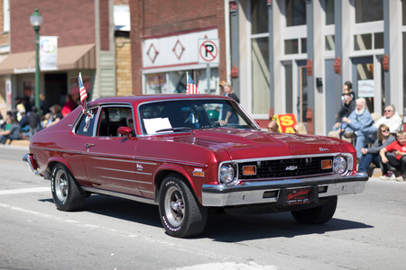 Orleans, Indiana, USA - April 28, 2018: The Orleans DogWood Festival and Parade, A classic car going down the street during the parade a Chevrolet Nova 350 color Red 写真素材 - 116830513