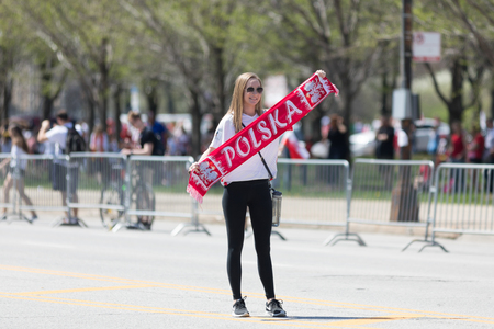 Chicago, Illinois, USA - May 5, 2018: The Polish Constitution Day Parade, Young polish woman holding a banner that says Polska during the parade