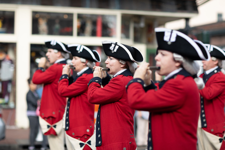 New Orleans, Louisiana USA - November 24, 2018: The Bayou Classic Parade, Old Guard Fife and Drum Corps marching band wearing traditional clothing performing at the parade.
