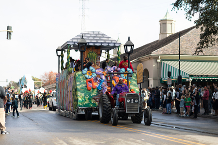 New Orleans, Louisiana USA - November 24, 2018: The Bayou Classic Parade, A float pulled by a tractor carrying the Grambling State University Bayou Classic Commitee at the parade Editorial