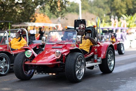 New Orleans, Louisiana USA - November 24, 2018: The Bayou Classic Parade, West Side Shrine Club members driving buggies during the parade