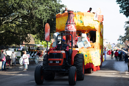 New Orleans, Louisiana USA - November 24, 2018: The Bayou Classic Parade, Float pulled by a tractor promoting Coca Cola, with a large coca cola bottle on it. Editorial