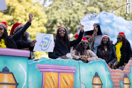 New Orleans, Louisiana USA - November 24, 2018: The Bayou Classic Parade, Float with suporters of Southern Jaguars football team at the parade