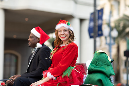 New Orleans, Louisiana USA - November 24, 2018: The Bayou Classic Parade, Man and woman wearing Christmas Outfits riding a carriage during the parade
