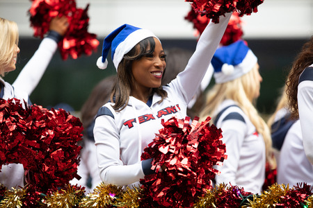 Houston, Texas, USA - November 22, 2018 The H-E-B Thanksgiving Day Parade, Cheerleaders from the Texans NFL Football Team, on a float during the parade