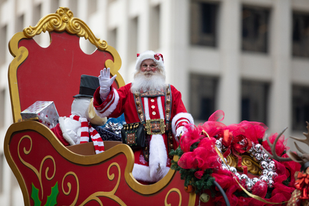 Houston, Texas, USA - November 22, 2018 The H-E-B Thanksgiving Day Parade, Man dress up as Santa Claus, riding a sleigh and waving at people, with presents Editorial