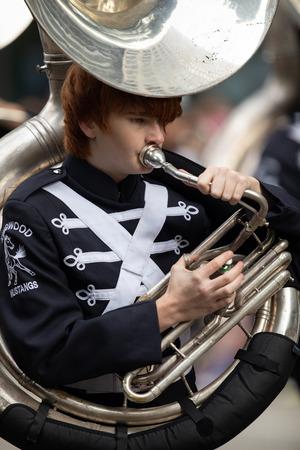 Houston, Texas, USA - November 22, 2018 The H-E-B Thanksgiving Day Parade, The Kingwood Mighty Mustang Marching Band performing at the parade
