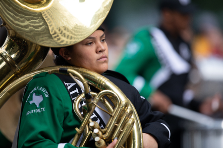 Houston, Texas, USA - November 22, 2018 The H-E-B Thanksgiving Day Parade, Members of the Stephen F. Austin High School marching band performing at the parade
