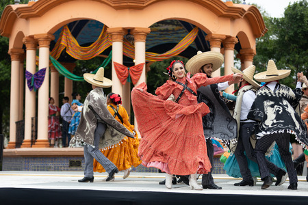 Matamoros, Tamaulipas, Mexico - November 20, 2018: The November 20 Festival, Young men and women wearing traditional mexican clothing, perform traditional mexican dances at the Plaza Miguel Hidalgo.