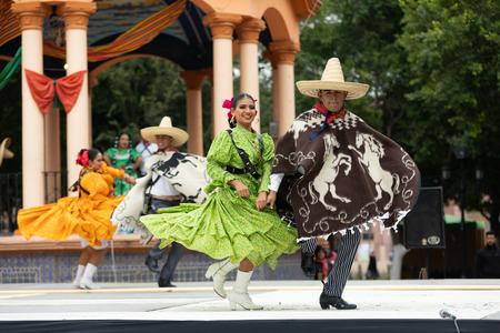 Matamoros, Tamaulipas, Mexico - November 20, 2018: The November 20 Festival, Young men and women wearing traditional mexican clothing, perform traditional mexican dances at the Plaza Miguel Hidalgo. Editöryel