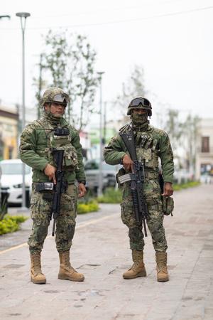 Matamoros, Tamaulipas, Mexico - November 20, 2018: Two Members of the Infanteria de Marina, Mexican Navy stand guard at the Miguel Hidalgo Plaza in Matamoros