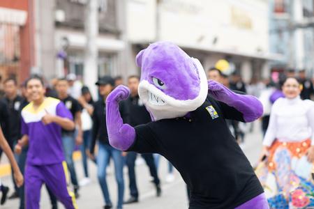 Matamoros, Tamaulipas, Mexico - November 20, 2018: The November 20 Parade, Man dress up as a shark, mascot of the Universidad del Atlantico