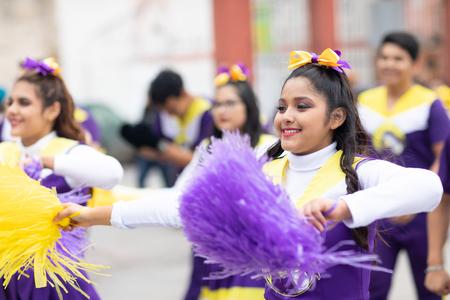 Matamoros, Tamaulipas, Mexico - November 20, 2018: The November 20 Parade, Mexican Cheerleaders dancing during the parade