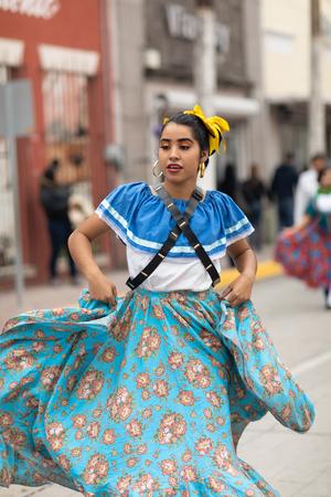 Matamoros, Tamaulipas, Mexico - November 20, 2018: The November 20 Parade, Young women wearing traditional mexican clothing dancing at the parade