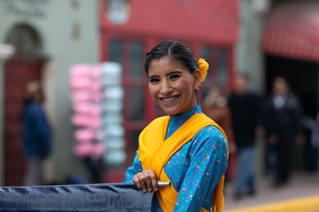 Matamoros, Tamaulipas, Mexico - November 20, 2018: The November 20 Parade, Young Mexican woman wearing traditional mexican clothing going down the road during the parade