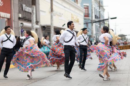 Matamoros, Tamaulipas, Mexico - November 20, 2018: The November 20 Parade, Young women and men dancing wearing traditional mexican clothing during the parade
