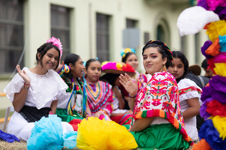 Matamoros, Tamaulipas, Mexico - November 20, 2018: The November 20 Parade, Young girls wearing traditional mexican clothing going down the road on a float