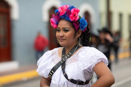 Matamoros, Tamaulipas, Mexico - November 20, 2018: The November 20 Parade, Young Woman wearing traditional Mexican clothing walking down the road