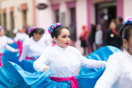 Matamoros, Tamaulipas, Mexico - November 20, 2018: The November 20 Parade, Young women wearing traditional Mexican clothing dancing