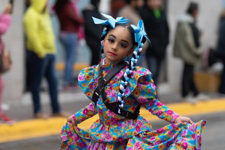 Matamoros, Tamaulipas, Mexico - November 20, 2018: The November 20 Parade, Young girl wearing traditional clothing dancing at the parade