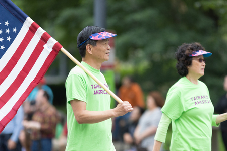 Washington, D.C., USA - May 28, 2018: The National Memorial Day Parade, Taiwanese Americans going down constitution avenue during the parade