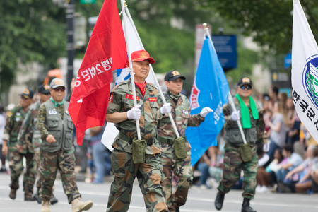 Washington, D.C., USA - May 28, 2018: The National Memorial Day Parade, Korean and vietnam veterans walking down constitution avenue Stock Photo - 116970729