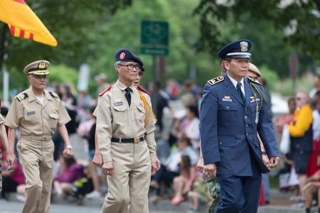 Washington, D.C., USA - May 28, 2018: The National Memorial Day Parade, Vietnam war veterans walking down constitution avenue during the parade 에디토리얼