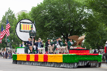 Washington, D.C., USA - May 28, 2018: The National Memorial Day Parade, Military Vietnam veterans going down constitution avenue on a float