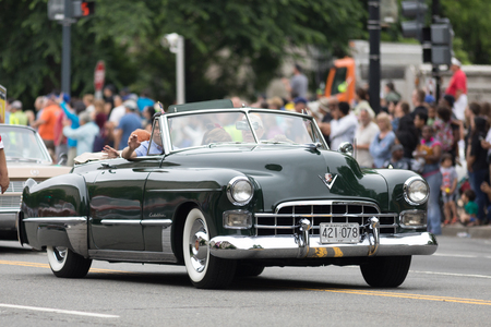 Washington, D.C., USA - May 28, 2018: The National Memorial Day Parade, Cadillac classic car going down contitution avenue