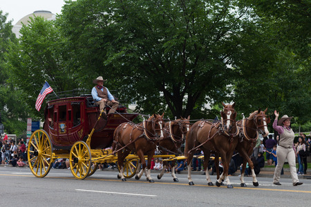 Washington, D.C., USA - May 28, 2018: The National Memorial Day Parade, Carriage from the Wells Fargo and Company, pulled by horses and with people dress up as cowboys
