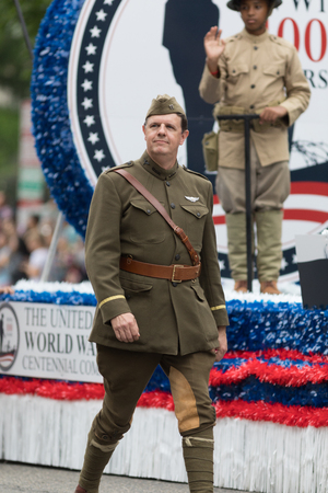 Washington, D.C., USA - May 28, 2018: The National Memorial Day Parade, Men dress up in world war one service men uniforms, going down constitution avenue