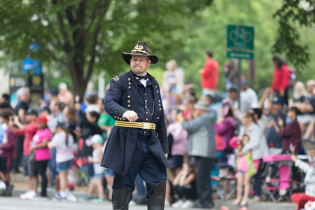 Washington, D.C., USA - May 28, 2018: The National Memorial Day Parade, Man dress up as civil war union soldier, walking down constitution avenue