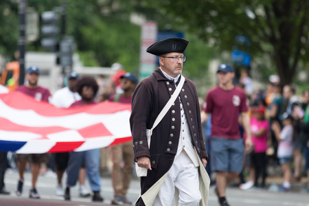 Washington, D.C., USA - May 28, 2018: The National Memorial Day Parade, Man dress up as soldier of the American revolution walks down constitution avenue.