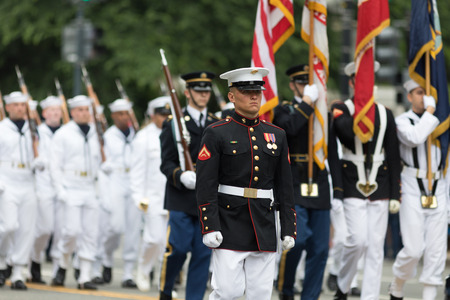 Washington, D.C., USA - May 28, 2018: The National Memorial Day Parade, Member of the United States Marine Corps marching down Constitution Avenue Editorial