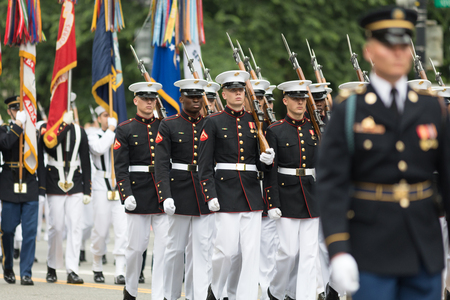 Washington, D.C., USA - May 28, 2018: The National Memorial Day Parade, Members of the United States Marine Corps marching down Constitution Avenue