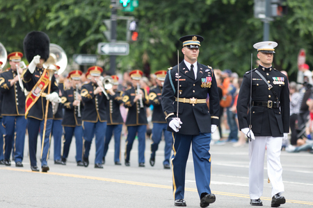 Washington, D.C., USA - May 28, 2018: The National Memorial Day Parade, Members of diferent branches of the United States Military in uniform marching together holding swords