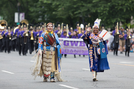 Washington, D.C., USA - May 28, 2018: The National Memorial Day Parade, People wearing traditional native american clothing, walking down constitution avenue