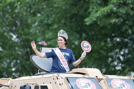 Washington, D.C., USA - May 28, 2018: The National Memorial Day Parade, MS Veteran America 2017 on top a military vehicle waving the american flag