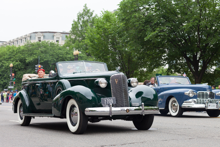 Washington, D.C., USA - May 28, 2018: The National Memorial Day Parade, a Cadillac Classic car with Military veterans, going down Constitution Avenue Editorial